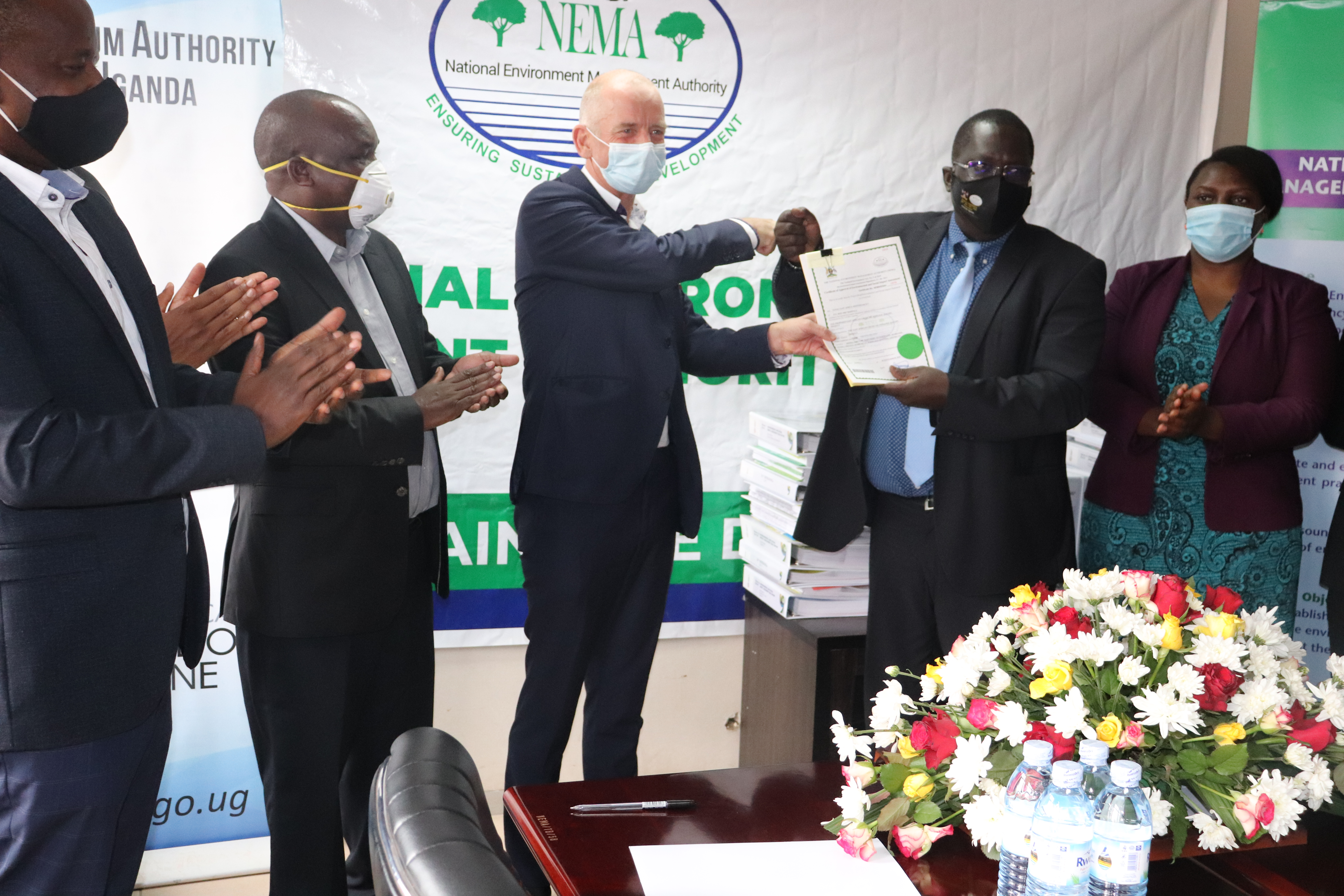 Martin-TiffenThird-Left-General-Manager-East-African-Crude-Oil-Pipeline-Project-EACOP-receives-ESIA-certificate-from-Dr.-Tom-Okurut-Second-Right-ED-NEMA